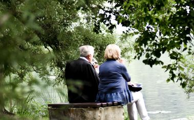 Old couple near lake